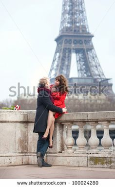 Romantic couple in love dating near the Eiffel Tower - stock photo
