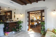 Rustic restaurant in traditional style enriched by the light of our classic collection Ferroluce.