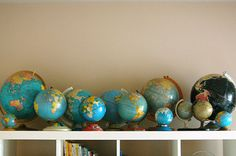 globe collection decor for kids playroom Globes Terrestres, World Globes, Vintage Maps, Etsy Vintage, Le Grand Bleu, Map Globe, We Are The World, Displaying Collections, Organization Ideas
