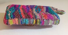 Knotted purse with tapestry strip edge.