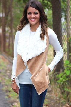 This vest is AMAZING. Super soft suede outer with hints of fur peeking through and super soft fur lined with the front flapping over and exposing it. Two front pockets. Tan in color with white faux fur. Definitely a must have for fall/winter...or at least all the TFL girls think so!