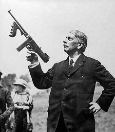 General John Taliaferro Thompson holding the Thompson Sub Machine Gun M1921