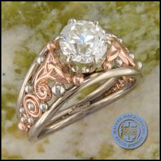 Unique Old European cut diamond set in a delicate 14k white and rose gold Celtic ring.
