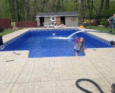 Inground pool we filled. One happy little girl.
