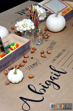 Thanksgiving Kids' Table Covered in Brown Paper and Full of Kid Activities...