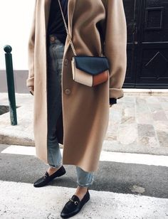 Oversized camel coat with jeans.