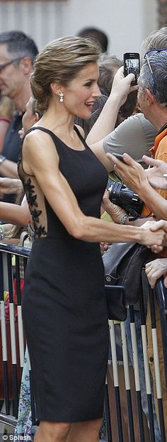 LBD: The royal wore a black dress with a sheer back and flower detailling