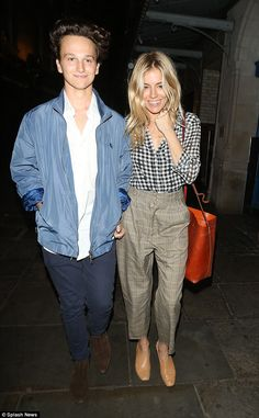 Two's company: The actress, 35, was truly radiant in her clashing gingham ensemble, as put...