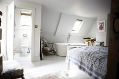 bedroom with bathtub, a paper aeroplane