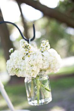 Simply chic white floral wedding ceremony decor; Via Northside Florist