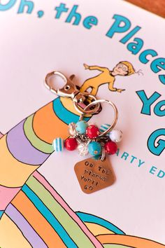 Oh the Places you'll go   Keychain  Metal Stamped Dr. Seuss. $10.50, via Etsy. (EDITED: got it, love it)