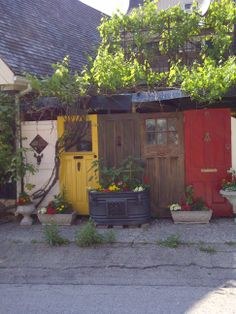 Took this picture in Elora Ontario.  The doors were used as a privacy fence. Love it!