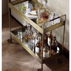 Store your bar tools, barware and booze on a vintage bar cart from Crate and Barrel. The Libations bar cart is a top seller and works with any style. Diy Bar Cart, Bar Cart Styling, Bar Cart Decor, Brass Bar Cart, Gold Bar Cart, Coffee Table Crate And Barrel, Coffee Tables, Chariot A Roulette, Küchen Design
