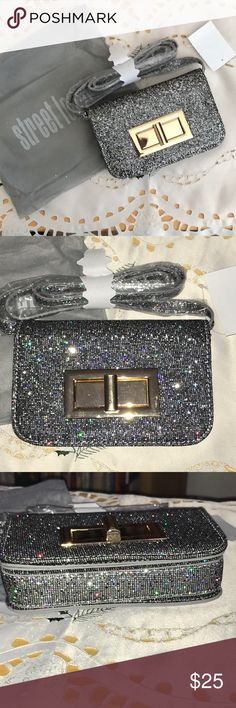 """Street Level sequin flap crossbody bag Street Level sequin flap crossbody bag Sequined flap and lice polished buckle adds high shine to this crossbody.  Color is Holo, silver sequins on black.  Magnetic snap flap closure Crossbody strap, interior wall pockets and mirror 7""""w x 4 1/2"""" h x 2""""d, 23 1/2"""" strap drop. NWT Street Level Bags Crossbody Bags"""
