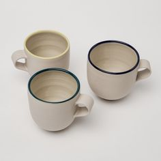 This mug is handmade with beautiful proportions.  The stoneware clay is hand-thrown and smoothed before fully dry, decorated with a tinted slip clay on the rim, and then finished with a transparent glaze on the inside and rim. The flat formed sturdy handle compliments the shape perfectly. With the exterior left unglazed, giving it a wonderfully tactile quality that is a joy to hold. Textures And Tones, Stoneware Mugs, Espresso Cups, Natural Texture, Compliments, Glaze, It Is Finished, Handle, Joy