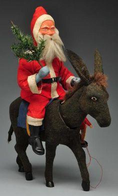 4,000.00 - 6,000.00 USD Rare Large Father Christmas Riding Donkey.  Description Father Christmas riding a nodding donkey wit...