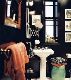 Extremely sexy, very masculine bathroom.  Great use of the color pop for extra effect.