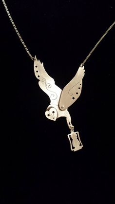 Sterling silver necklace. Barn owl woodland pendant with dangling lantern. Handmade and unique pendant on sterling silver chain.