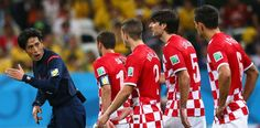 The croatian team is ganging up on the referee because he filed in favor of Brazil.