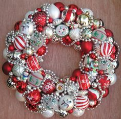 Made by Judy Blank  I LOVE this wreath!  She has so many fabulous ones in her Esty shop. DROOL!  Vintage Glass Ornament Christmas Wreath Shiny Brite by judyblank, $150.00