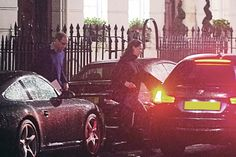 Kate and Will braved the rain after leaving their joyful appointment at a London clinic on Oct. 15, 2014.