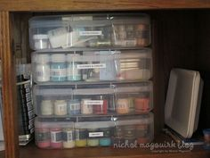 I keep all my paints, Stickles, flocking, glitters, etc. in THESE magazine plastic containers from the Container Store.