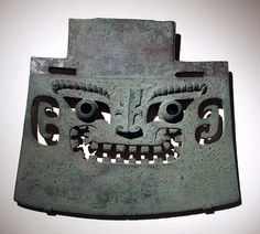 From Wikiwand: A bronze axe of the Shang dynasty