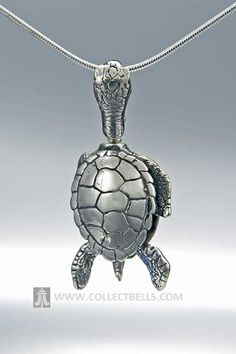 """This silver necklace is a bell is in the shape of a turtle's shell, with the head as the bail and it's hind legs and tail make the clapper. This pendant comes with a story card that reads: """"The sea turtle is a brave and beautiful creature. It faces many dangers throughout its life and its struggle to survive is truly remarkable. From the beach of its birth and the predators there, to the dangers it faces at sea. May this bell remind you it may not be easy, but with determination, you can do…"""