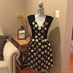 Tracy Reese for Anthropologie dress Anthropologie exclusive Tracy Reese black cocktail dress with gold polka dots. Black sleeve and back is stretchy knit, v neck, back zip. Extremely comfortable and lightweight! No trades. Anthropologie Dresses