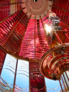 Inside the nine-foot high first order Fresnel lens at Umpqua River Lighthouse in Oregon. Built in 1894, Umpqua used the identical construction plan as the famous Heceta Head Light. However, Umpqua got this beautiful ruby and clear crystal Fresnel. The lighthouse is open for tours, and visitors get a chance to pop up into the interior of the lens and watch this massive red and white beauty rotate around you.