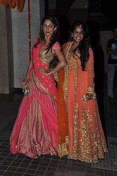 Amrita Arora in Shantanu & Nikhil with Arpita Khan Sharma while attending Soha Ali Khan and Kunal Khemu's wedding