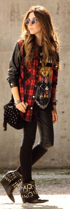 An example of rock style, there's the vintage tee shirt, the grunge look with the plaid and the leather sleeves and pants. There is also the studded purse and shoes. 3/31/16.