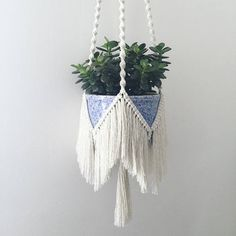 This macrame plant hanger is made from 100% cotton rope and hangs from a wooden O ring. This plant hanger is ideal for hanging a wide range of plant pots and is a great addition to any room in the house. It is a truly bohemian piece with its perfectly combed fringe and long twisted
