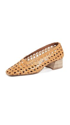b1fefd41ff2a Miista Women s Taissa Block Heel Pumps. Nothing says summer better than  woven raffia. These Miista pumps take the natural style and amp up the  glamour and ...