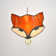 Meet Foxy!! This adorable little stained glass foxy nightlight is great for a babys nursery, childrens room and if you are like me I love them in my bathrooms! This piece would be a sweet baby shower gift, or a cute addition to your room! The fox hangs from the top on a shepherds hook. These nightlights are great because you can interchange the stained glass for another piece without having to buy another nightlight. Whether you are changing up cute little animal heads or changing them for…