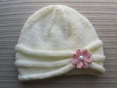 This hat is made on straight needles and has a seam.If you would like to make it…