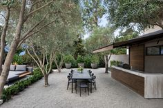 This outdoor kitchen and dining area looks out to the pool, and sits among a grove of olive trees. Modern Landscape Design, Modern Landscaping, Contemporary Landscape, Outdoor Landscaping, Landscaping Ideas, Indoor Outdoor Living, Outdoor Fire, Outdoor Dining, Moderne Pools