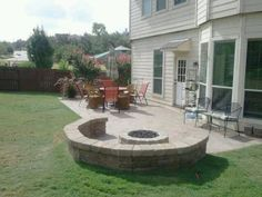 Outdoor fire pit. Would like to add some cushions to the outer semi-circle.