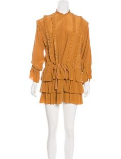 #ULLAJOHNSON | Orange Ulla Johnson dress with ruffle trim throughout, long sleeve, drawstring at waist and concealed snap closures at bust.