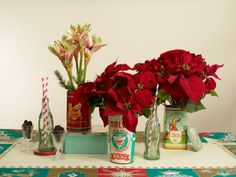 Repot your holiday poinsettias and Amayllis out of the containers they come in and instead put them in flour tines, coffee containers, tomato sauce cand or cookie jars - any tin with an interesting design or logo will work.  Mix in soda pop bottles and vintage cordials with mini pinecones to give it a more vintage feel.