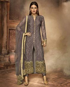 1. Gray net embroidered straight suit 2. Self thread heavy embroidery with zari thread cutwork highlighted with rhinestones and fancy buttons 3. Comes with a matching shantoon bottom and net dupatta 4. Can be stitched up to size 42