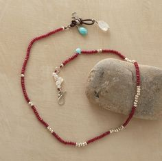 """red racer necklace    Named for a graceful snake that moves like a windswept ribbon, our exclusive ruby strand is handcrafted with sterling silver beads, turquoise, moonstone and cultured pearls by Naomi Herndon. Hook clasp. Approx. 17-1/2""""L."""