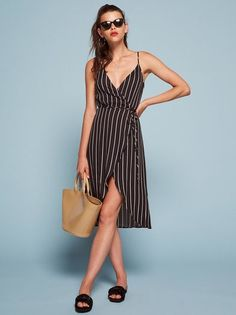You might need a bit of boob tape. This is a midi length, wrap dress with a low v neckline.