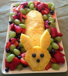Love this, Easter bunny made from pineapple, fruit on the side. Yum!