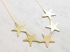 D E S I G N • I have created (drawn, designed, cut and pieced together) this fun golden star necklace. Simple yet effective, this light and stylish