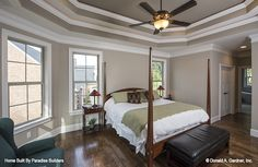 Master bedroom with a tray ceiling! New photos of The Sandy Creek house plan 1329-D built by Paradise Builders in Inman, SC! #WeDesignDreams #DonGardnerArchitects