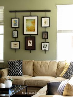 living rooms - Kelly-Moore Green Moss, yellow living room, yellow and black family room, Pottery Barn hanging studio Easle, Art gallery wall, art gallery in family room, bird decor,
