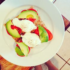 Crisp toast, avocado, poached eggs, and tomatoes