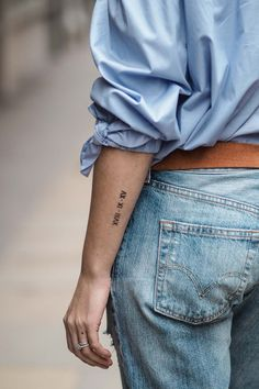 Wedding date arm tattoo in roman numerals.