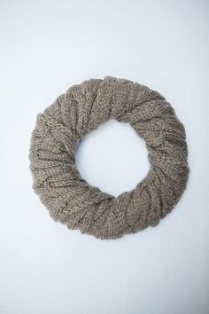Winter knit scarf wreath DIY - wreath form, safety pins, a thick scarf, and add a bow.  Done!